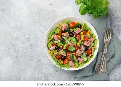 tuna salad in white bowl, top view, copy space