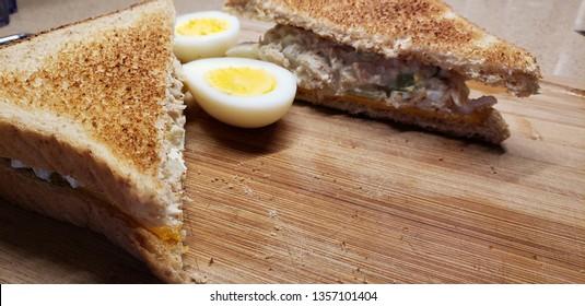 tuna sandwich and boiled egg cut in half