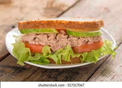 Tuna Sandwich on white plate.