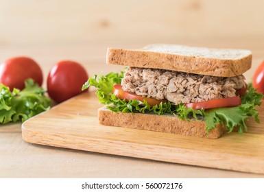 tuna sandwich on wood board
