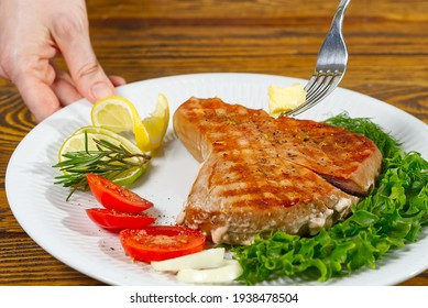 Tuna steak cooked on the electric grill. tunafish served on a plate with fresh herbs and vegetables. healthy nutritious, Healthy Eating for a Healthy Weight