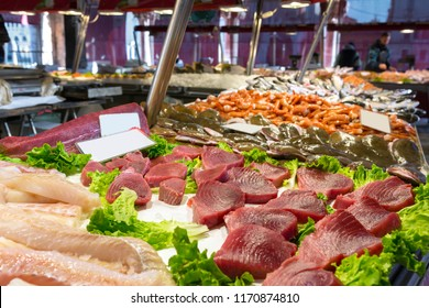 Tuna steaks and other fish meat at Mercato Ittico di Rialto - venetian fish market in Venice, Italy