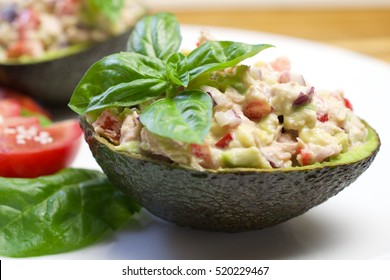 Tuna stuffed avocado. Avocado tuna salad. Healthy lunch - tuna stuffed avocado. Tuna salad