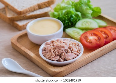 Tuna, tomato, cucumber lettuce cream and bread Sandwich ingredients