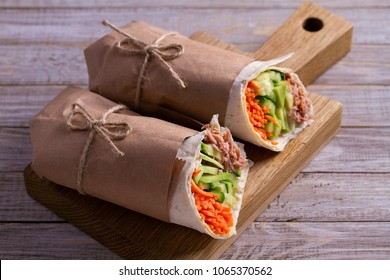 Tuna wraps. Wraps with tuna fish, cucumber, avocado and carrot. Homemade tasty burrito