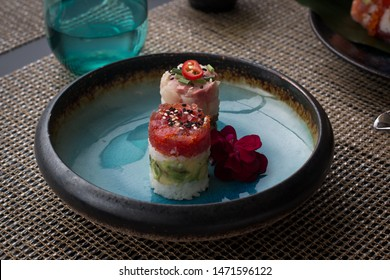 Tuna and Yellw-tail fish tartare, served in a deep stoneware plate with a blue crackle glaze.