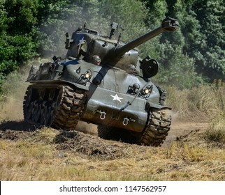 TUNBRIDGE WELLS, ENGLAND, JULY 28, 2018 - Restored World War 2 Sherman tank, and members of the public, take part in the annual War and Peace Revival Show and re-enactments
