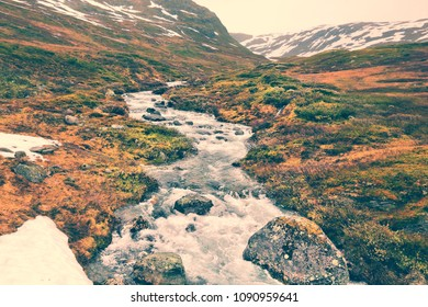 Tundra landscape in Norway. Mountain stream in Aurlandsfjellet. Vintage filter stylized colors.