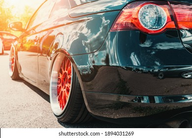 Tuned sport car with custom wheel and low profile like lowrider style