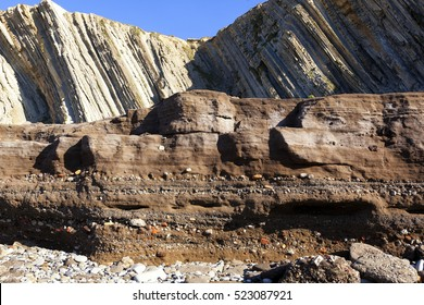 Tunelboca cemented beach in Biskay, Spain. Sample of the anthropocene age, with a layer of industrial sediments in the coast, formed by the wastes of the former Altos Hornos de Vizcaya steel mill