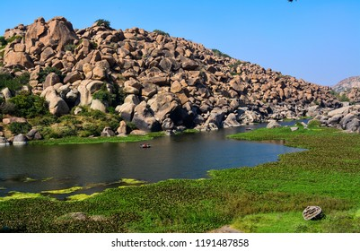 The Tungabhadra River is a river in India that starts and flows through the state of Karnataka during most of its course. The image is captured in Hampi, the UNESCO World Heritage Site in India.