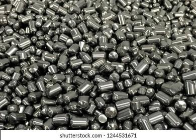 Tungsten cylinders. Ingots of tungsten in a pile