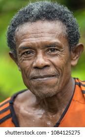 TUNGU VILLAGE, ARU ISLANDS, INDONESIA, DECEMBER 06, 2017 : Portrait of a jungle hunter near the Tungu village in Aru islands, Papua, Indonesia.