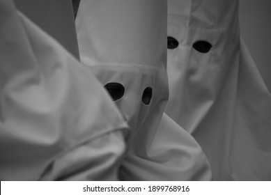 the tunics of penitents in procession - Shutterstock ID 1899768916