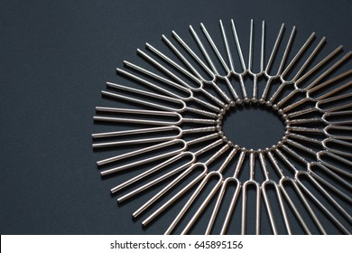 Tuning fork round pattern on a black background