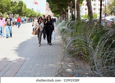 TUNIS CITY, TUNISIA - CIRCA MAY, 2012: Tunisian people life between barbed wire on the streets of capital on circa May, 2012 in Tunis city, Tunisia, Africa
