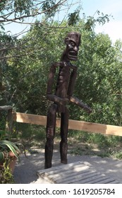 TUNIS, HAMMAMET-APRIL 30, 2019: wooden sculpture of a black man-guard Friguia Park