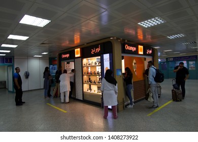 Tunis, Tunisia - 13 October 2018: Tourist approaching a local telecom shop at airport.