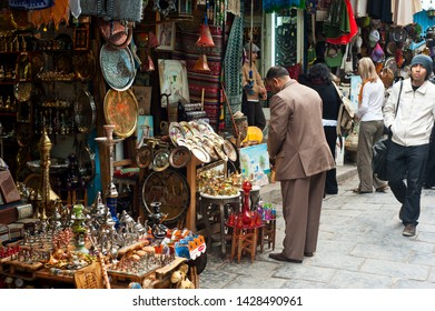 Tunis, Tunisia - April 13, 2012 - Shoppers stroll the tunnels of the Medina (old city) in Tunis, Tunisia. The Tunis Medina is a UNESCO World Heritage Site.