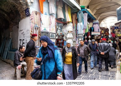 TUNIS, TUNISIA- APRIL 4: Tourists and locals in the traditional medina market in Tunis, Tunisia on April 4, 2018