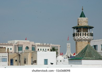 TUNIS, TUNISIA - MAY 17, 2010: Minaret of a mosque and houses, in the Medina of the city