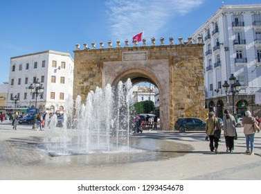 TUNIS, TUNISIA - November 22, 2018: The Triumphal Arch, fountains and pedestrians at the entrance to Medina in the capital of Tunisia in the city of Tunis in the historic district