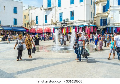 TUNIS, TUNISIA - SEPTEMBER 2, 2015: The small fountain on the Beb Bhar square is the favorite place for the children's games, on September 2 in Tunis.