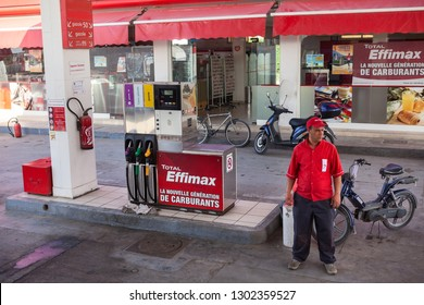 TUNISIA, AFRICA-CIRCA MAY, 2012: Service man is on petrol station with Total Effimax gasoline. Effimax is the new generation of advanced fuel created by Total technological research center
