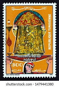 """TUNISIA - CIRCA 1986: A stamp printed in Tunisia from the """"Wedding Dresses"""" issue shows wedding dress from Nabeul, circa 1986."""