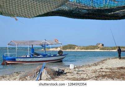 Tunisia, Djerba, Blue lagune, fishing boat.