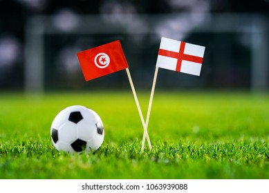 Tunisia - England, Group G, Monday, 18. June, Football, National Flags on green grass, white football ball on ground.