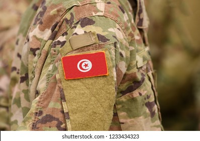 Tunisia flag on soldiers arm. Tunisia troops