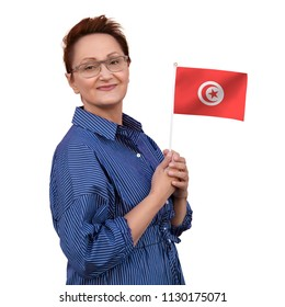 Tunisia flag. Woman holding flag of Tunisia. Nice portrait of middle aged lady 40 50 years old with a national Tunisian flag isolated on white background.