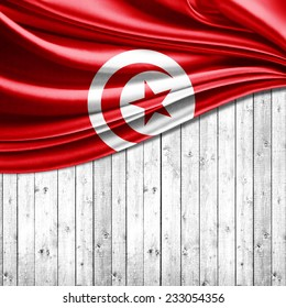 Tunisia flag and wood background