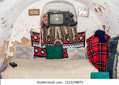 Tunisia, Matmata. Simple belongings in the cave-bedroom in the caves-dwellings of Berbers - traglydites (translated-living in caves).