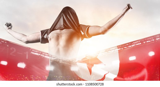 Tunisia national team. Double exposure photo of stadium and soccer or football player celebrating goal with his jersey on head
