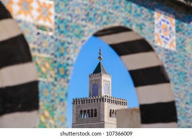 Tunisia old town of Medina. Terrace of Palais d'Orient with minaret of Zitouna Mosque