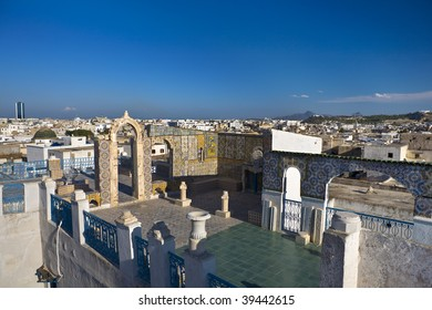 Tunisia. Tunis - old town (medina). Terrace of Palais d'Orient with ornamental arches and wall covered tiles