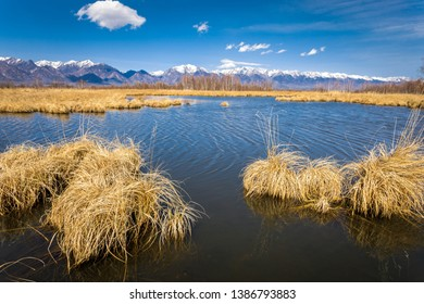 Tunka valley, coimor lakes, lake on the background of mountains with snowy peaks