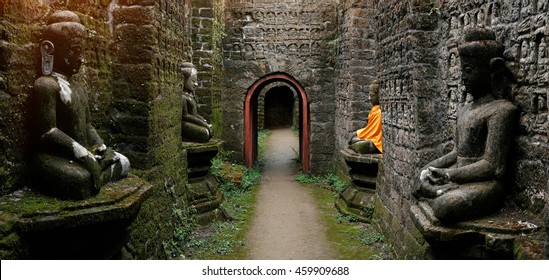 Tunnel with ancient Buddha statues in Kothaung Paya temple in Mrauk-U city, Rakhine state, Myanmar