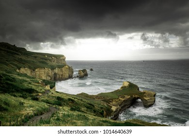 Tunnel beach view during cloudy weather, Dunedin, New Zealand