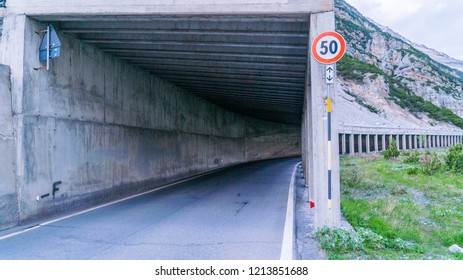 Tunnel by lake Livigno