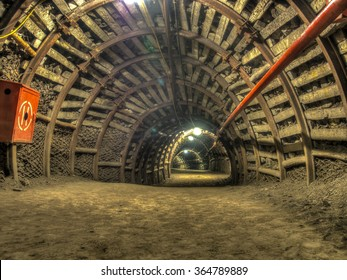 A tunnel in a coal mine leading deep  into the earth
