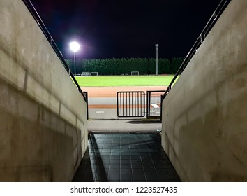 The tunnel and entrance way into an athletics stadium at night