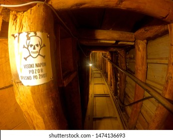 """The tunnel of hope built during the siege of Sarajevo during the Bosnian War. Civilians escaped the town of Sarajevo through this tunnel. The sign reads """"high voltage attention life-threatening"""""""