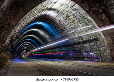 Tunnel with light trail