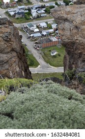 Tunnel like perspective with rocks and town and city
