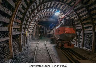 Tunnel in the mine, track, coal car