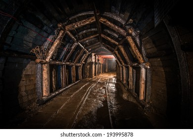 tunnel in old coal mine, reinforced with wood