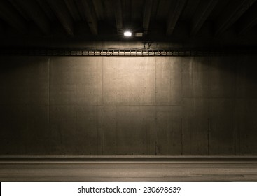 Tunnel road area with spotlight on the wall